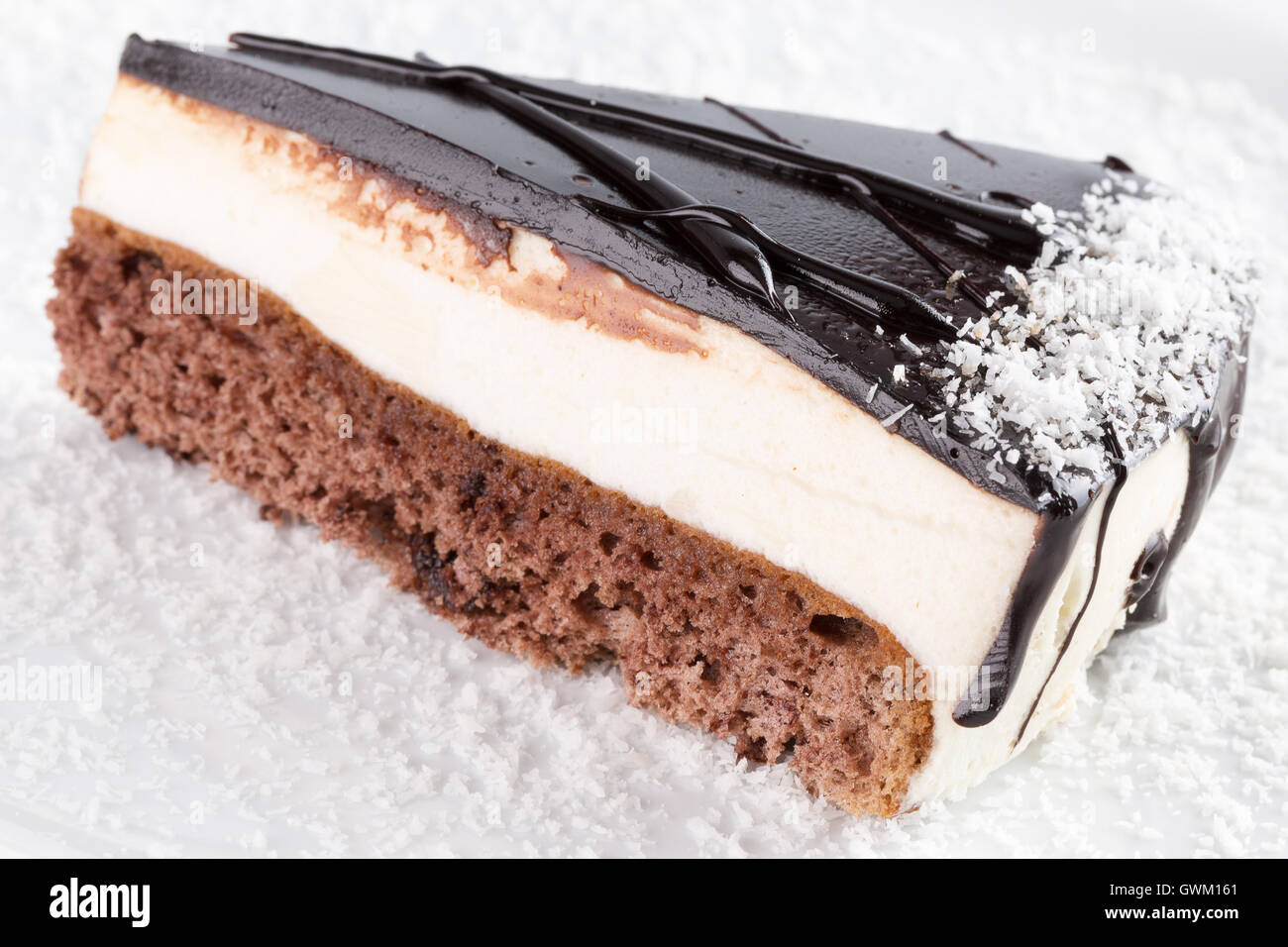 chocolate cheese cake on white plate. - Stock Image