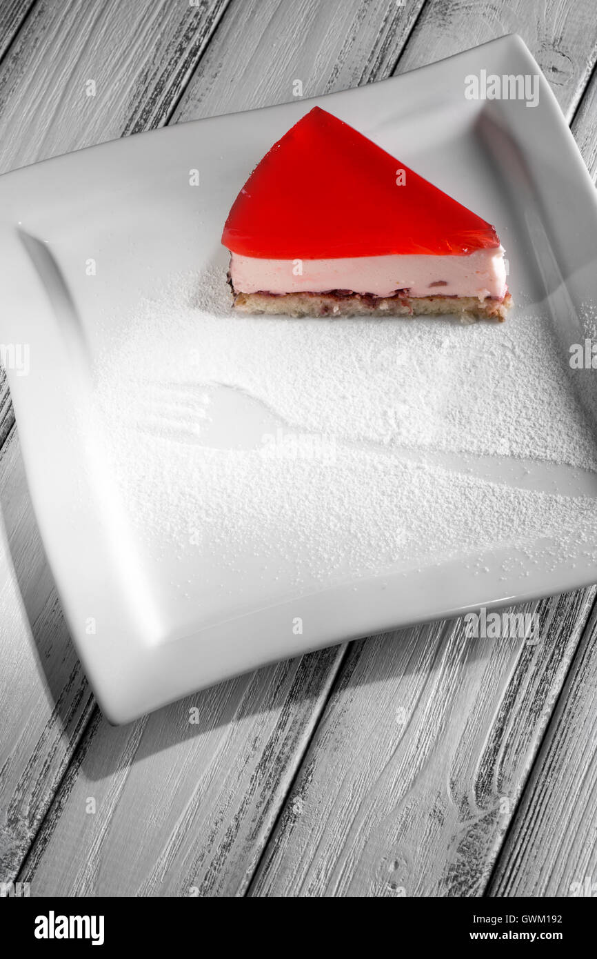 piece of jelly cake on white wooden background. - Stock Image