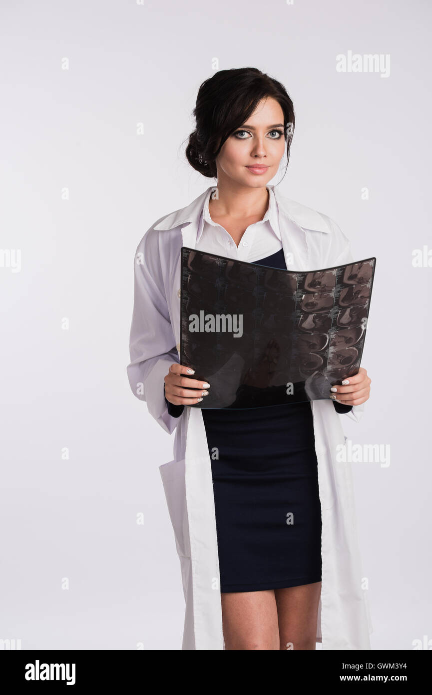 Female doctor looking at radiographs x-ray - Stock Image