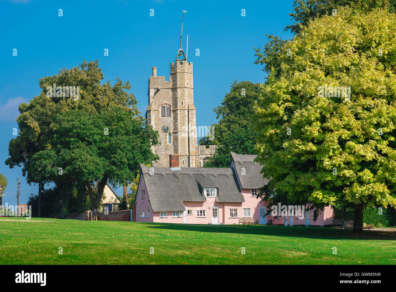 Cavendish Suffolk, village green in Cavendish,Suffolk, with medieval church and row of pink cottages, England, UK - Stock Image
