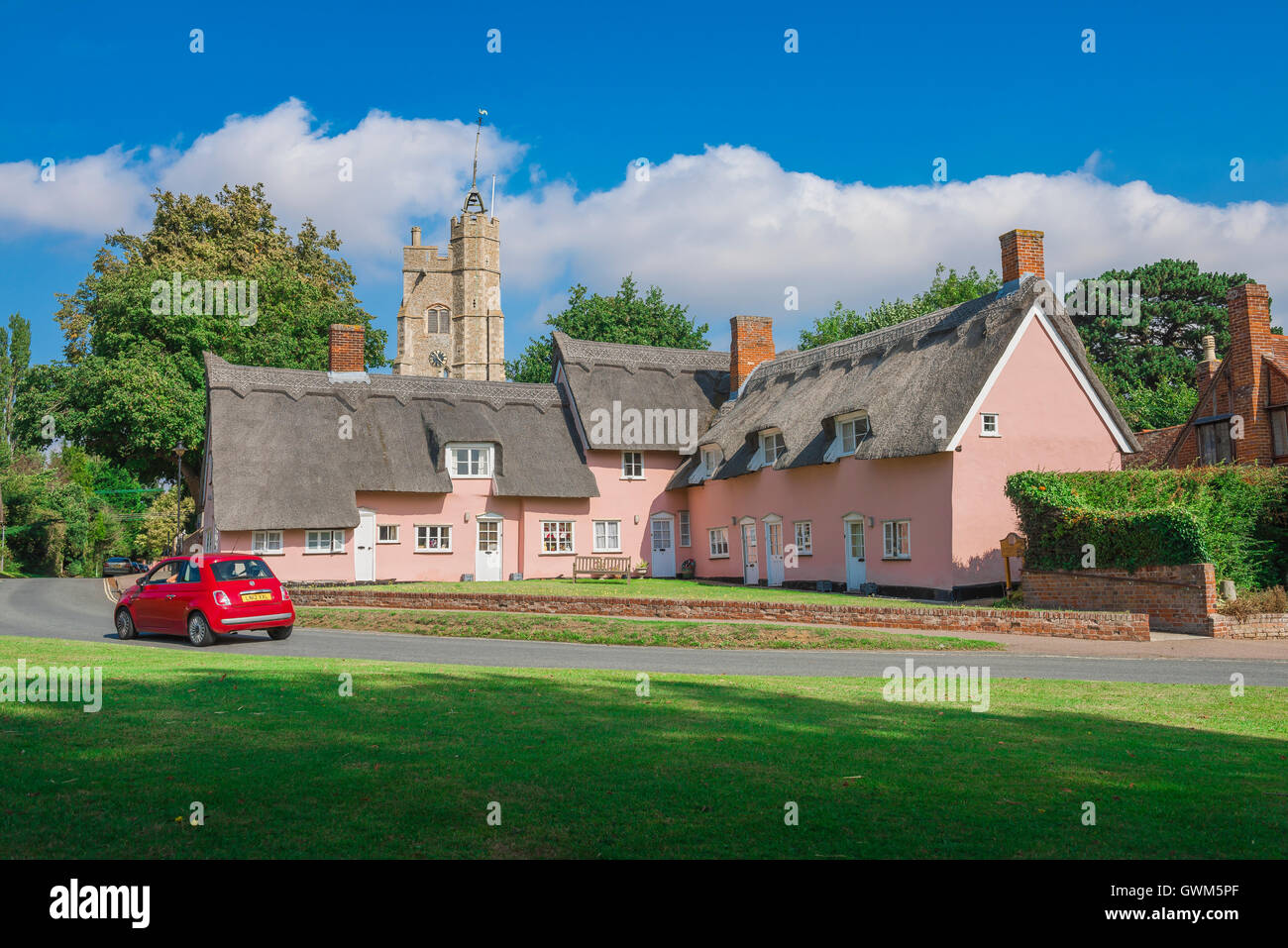 England village green, the village green in Cavendish, Suffolk, with the medieval church and pink cottages England, - Stock Image