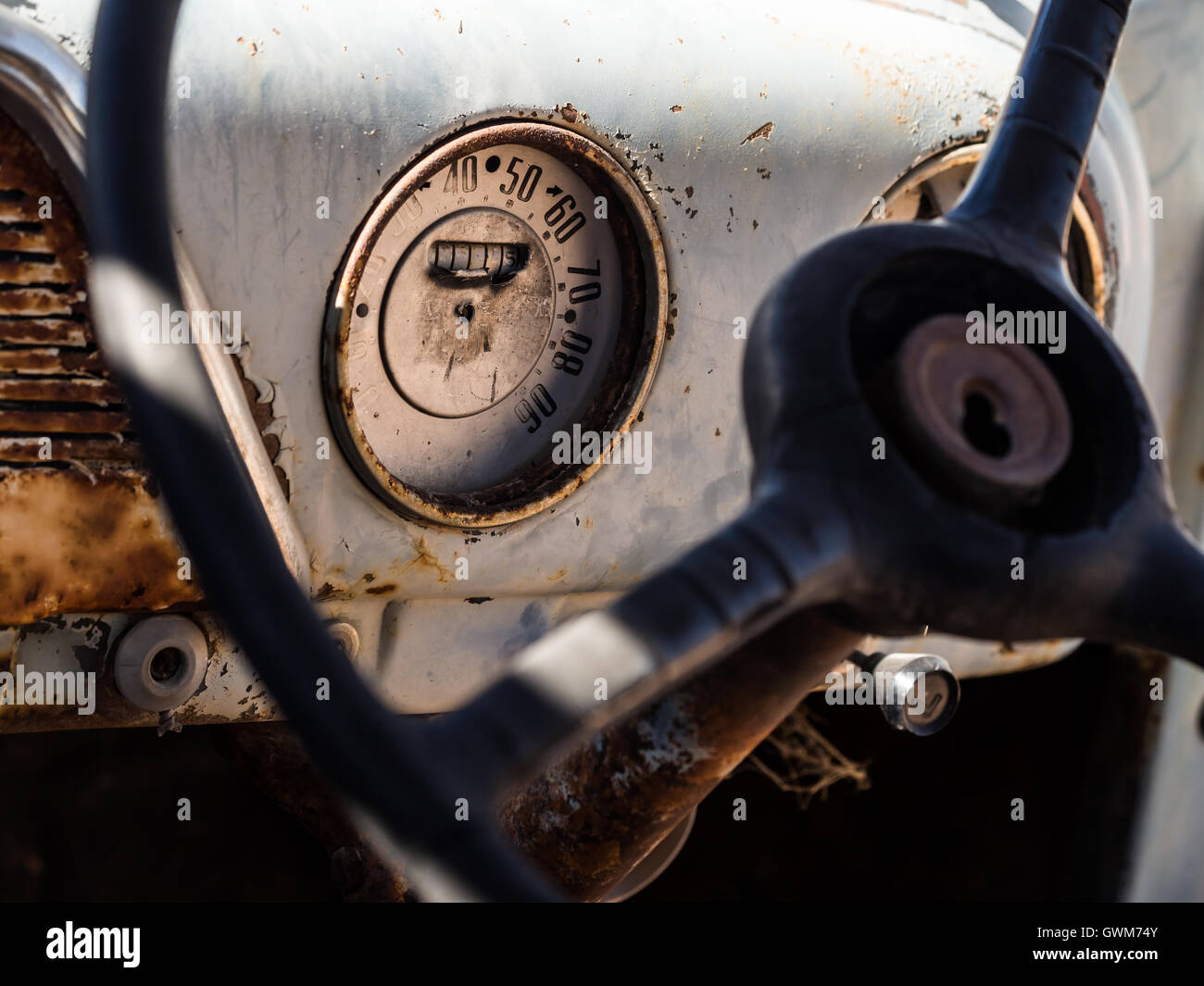 Speedometer and dashboard of an old wreck car left in Solitaire on the Namib desert. - Stock Image