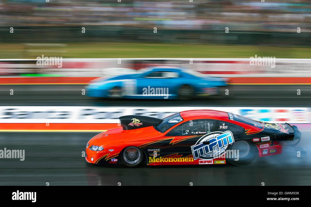 Pro Stock drag racing at Santa Pod.  Magnus Petersson in his Pontiac GTO V Bengt Ljungdahl in his Chevrolet Camaro - Stock Image