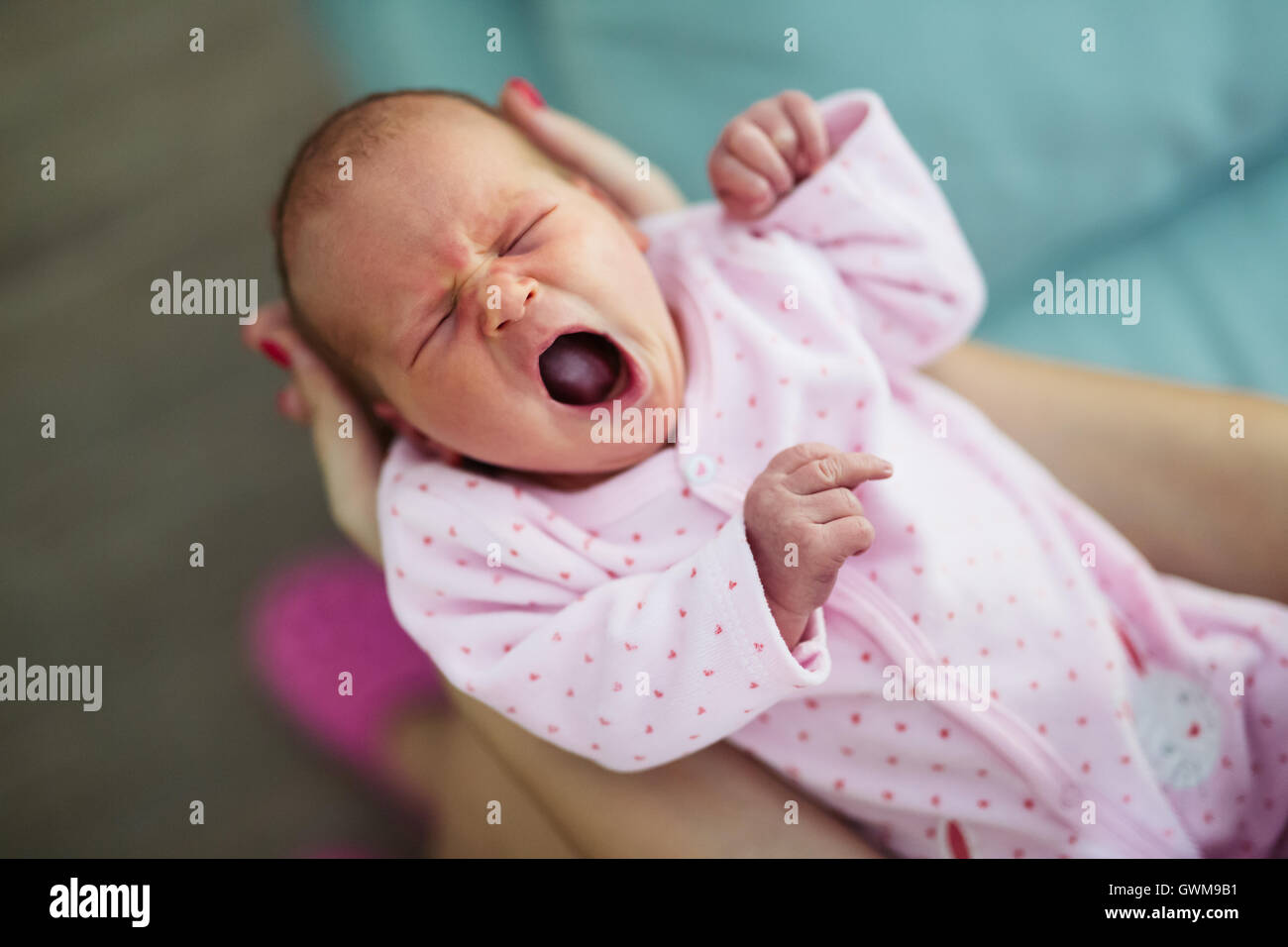 Screaming cute babies and restless nights are inevitable - Stock Image