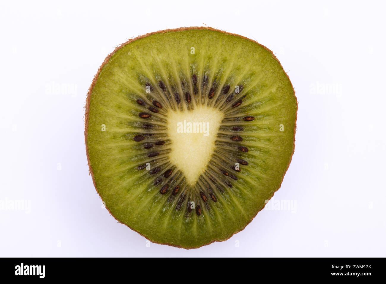 Halved kiwi fruit with heart shaped center. Kiwi fruit is said to promote heart health - Stock Image