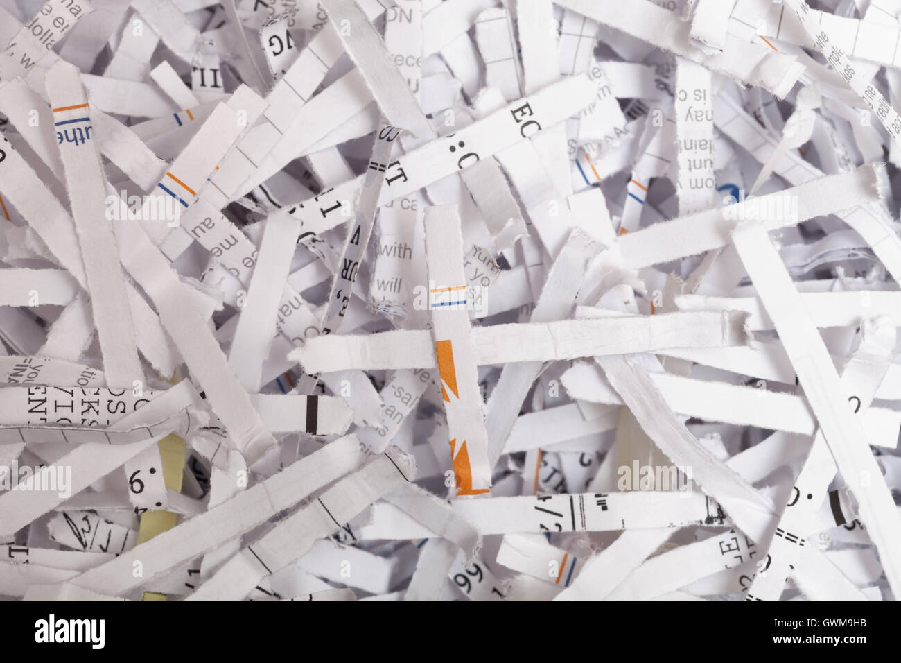 Full frame high angle view of shredded paper documents - Stock Image