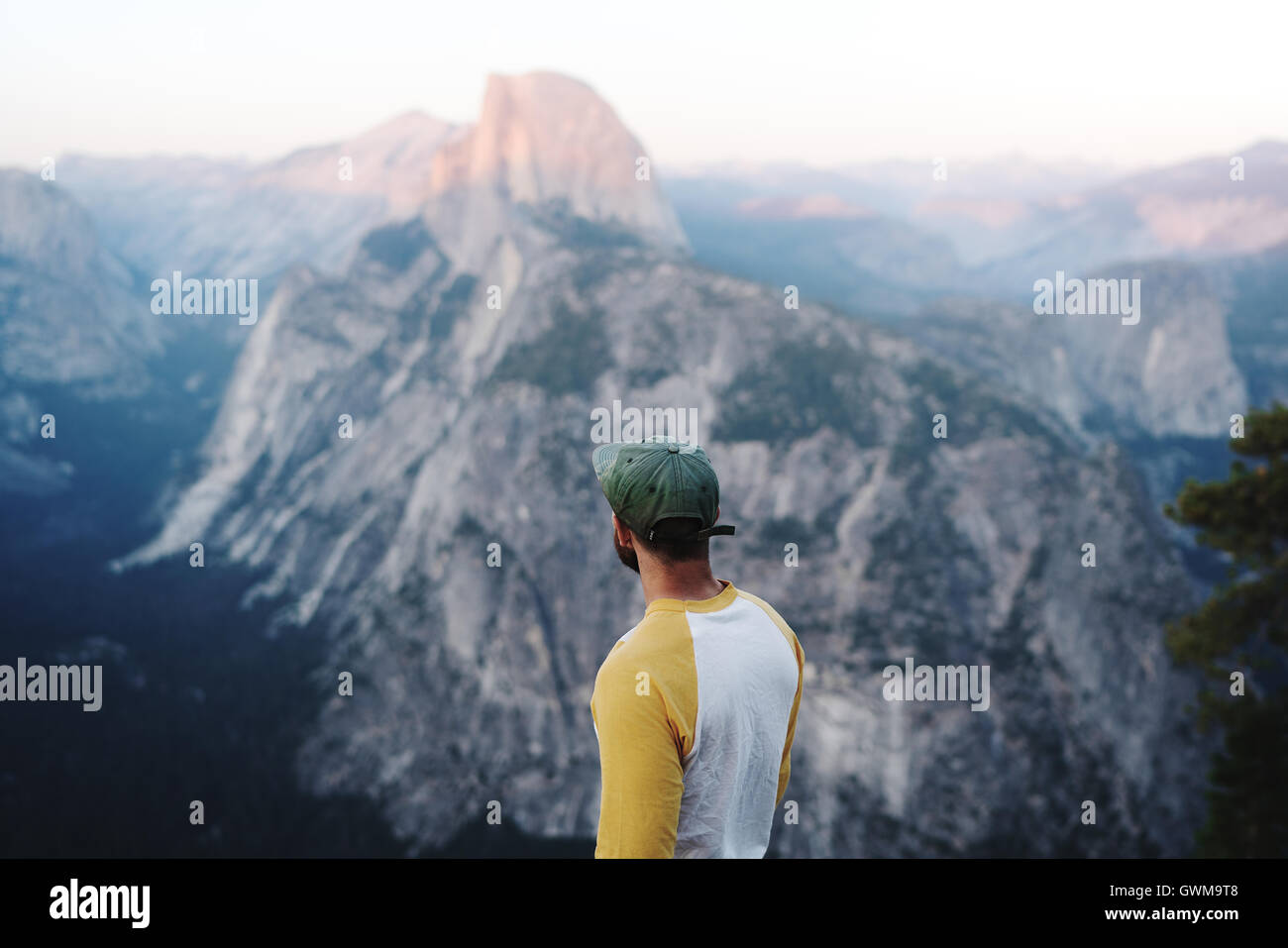 A hiker views Half Dome in California's Yosemite National Park - Stock Image