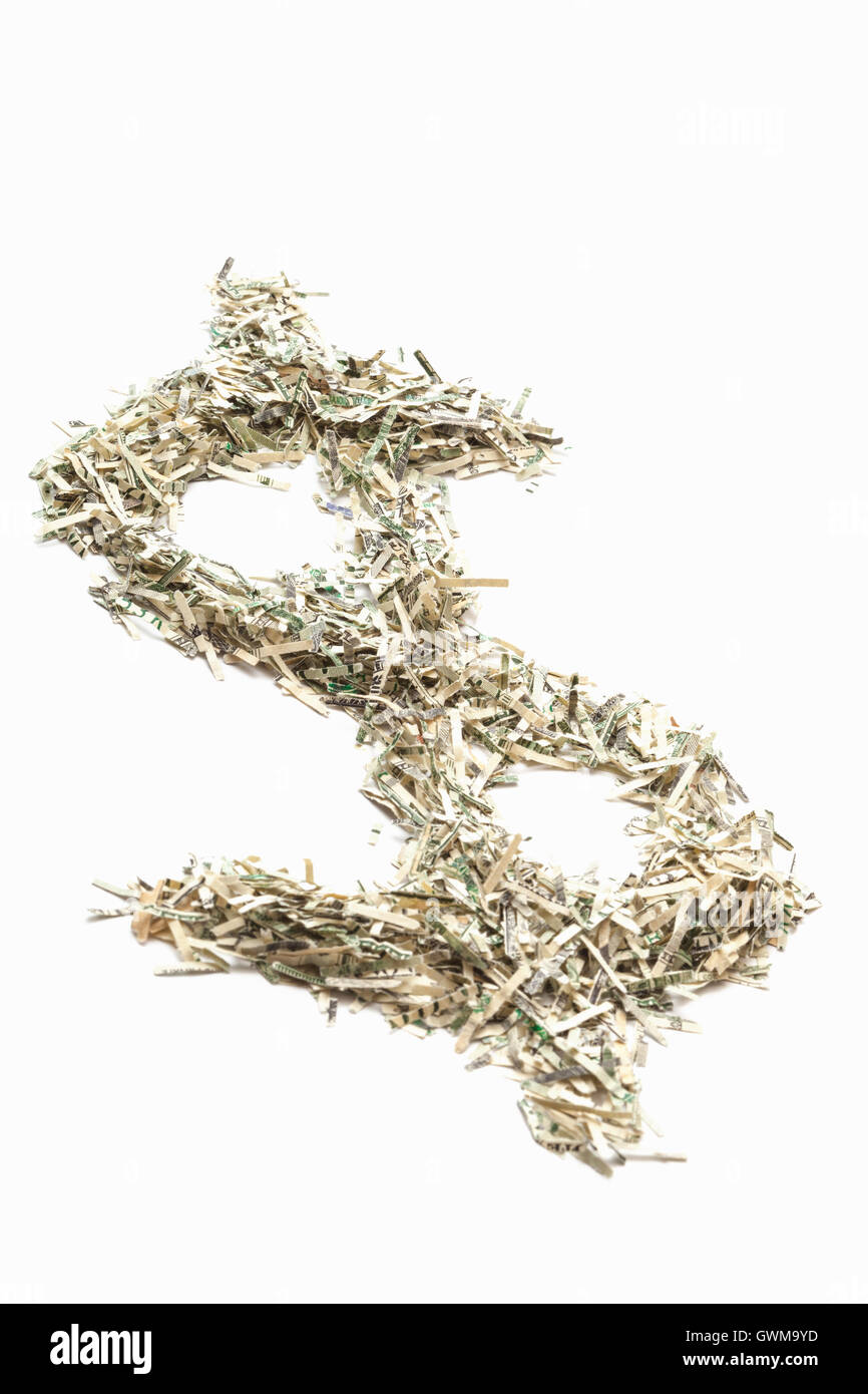 Shredded US currency in the shape of a dollar sign - Stock Image