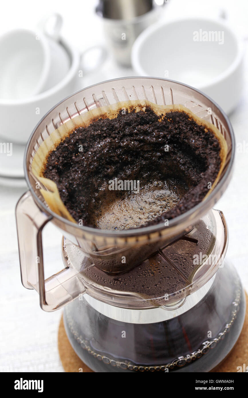 making hand drip coffee by paper filter - Stock Image