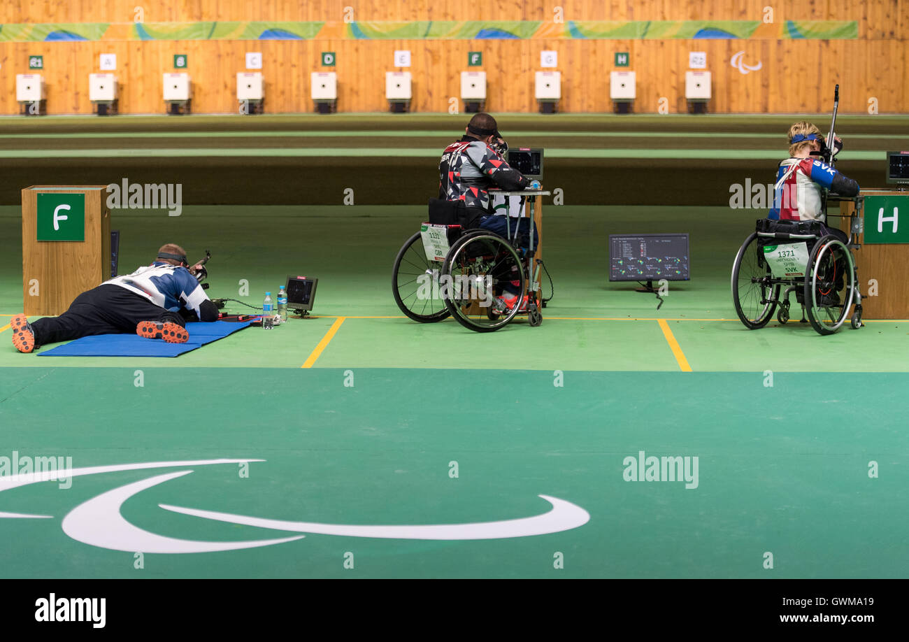 Great Britain's Matt Skelhon (centre) competing in the R6 - Mixed 50m Rifle Prone SH1 Final at the Olympic Shooting - Stock Image