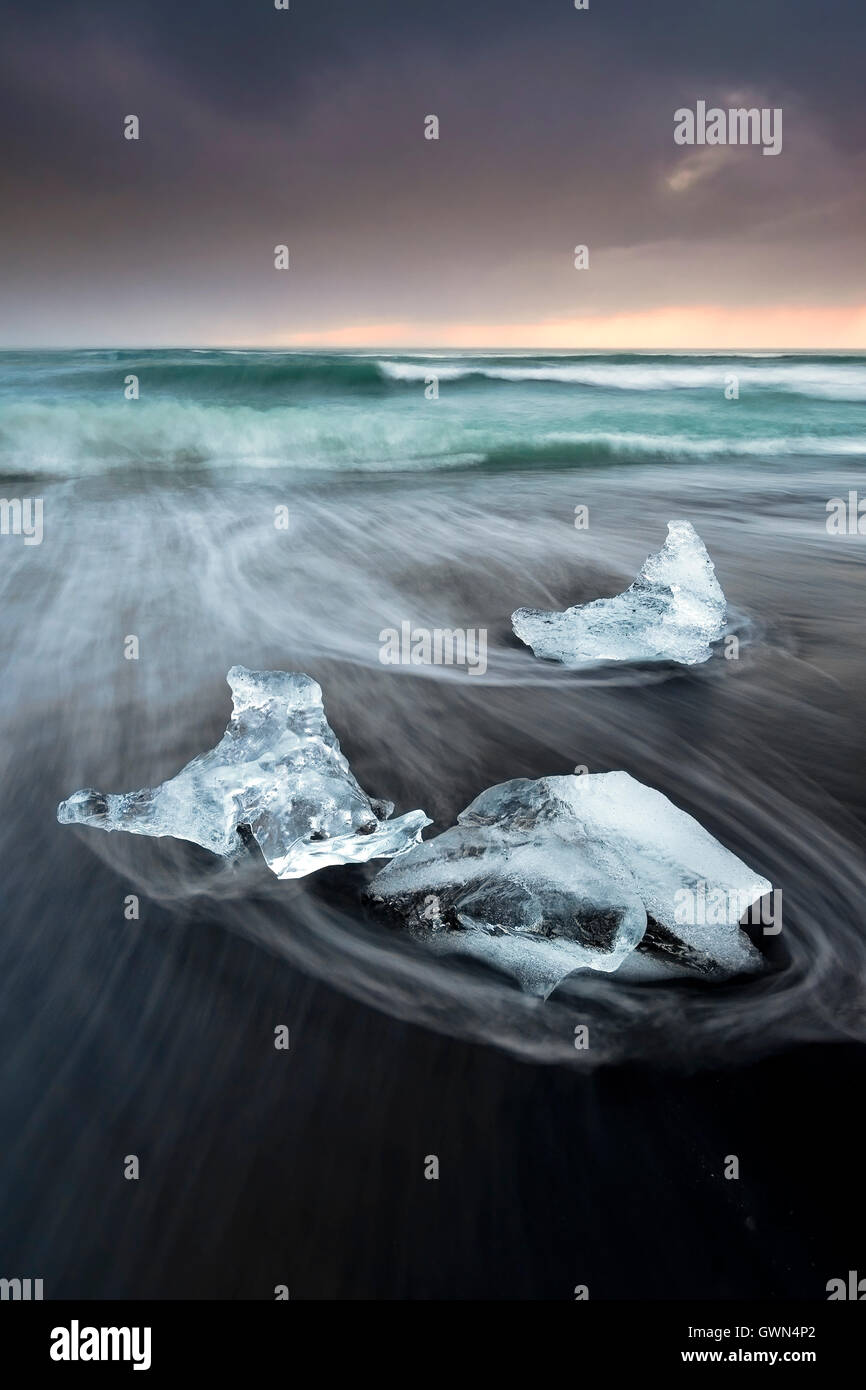 Icebergs on Jokulsa Volcanic Beach at Sunrise, Jokulsarlon, Near Hofn, Southern Iceland - Stock Image