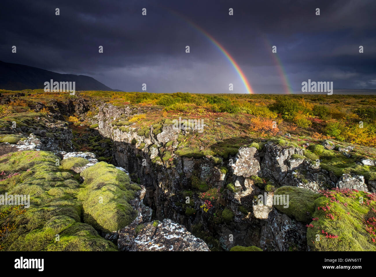 Rainbow and Rainstorm over Volcanic Landscape & Tectonic Plate Fissure, Thingvellir National Park, South Western - Stock Image