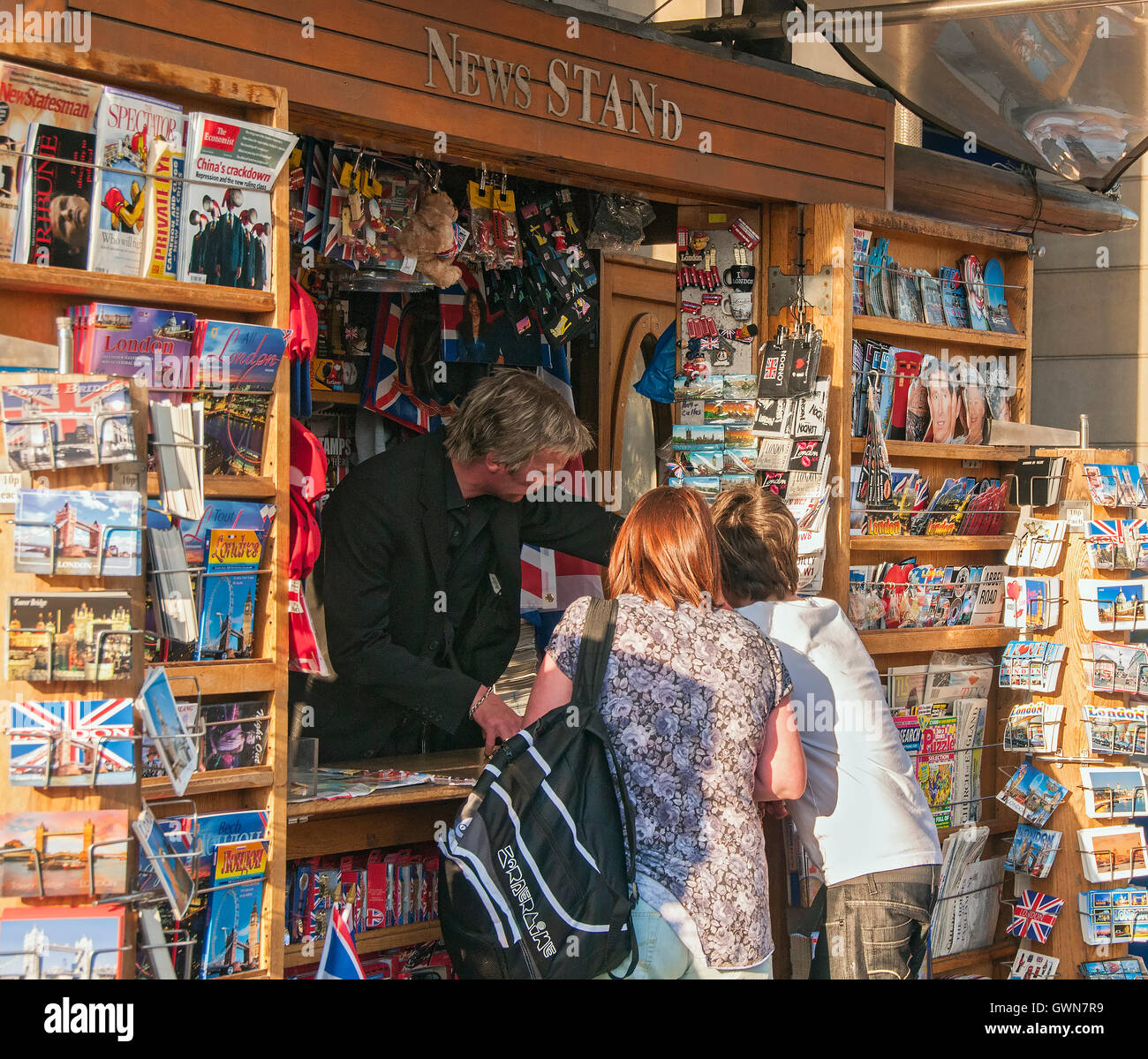 Customers at a News Stand in Westminster, London, England, UK - Stock Image