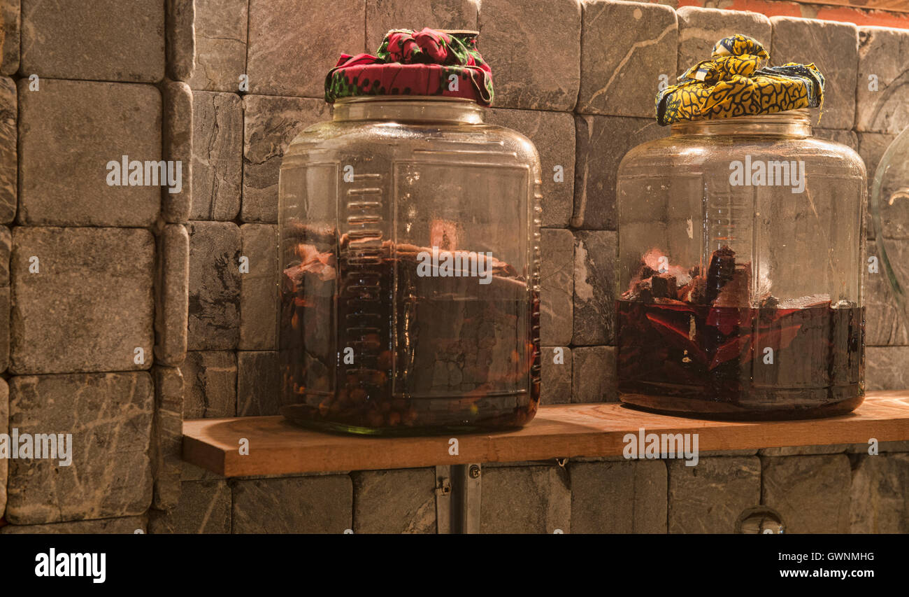 Jars of ya dong (Thai white spirits with medicinal herbs) at a bar in Bangkok, Thailand - Stock Image