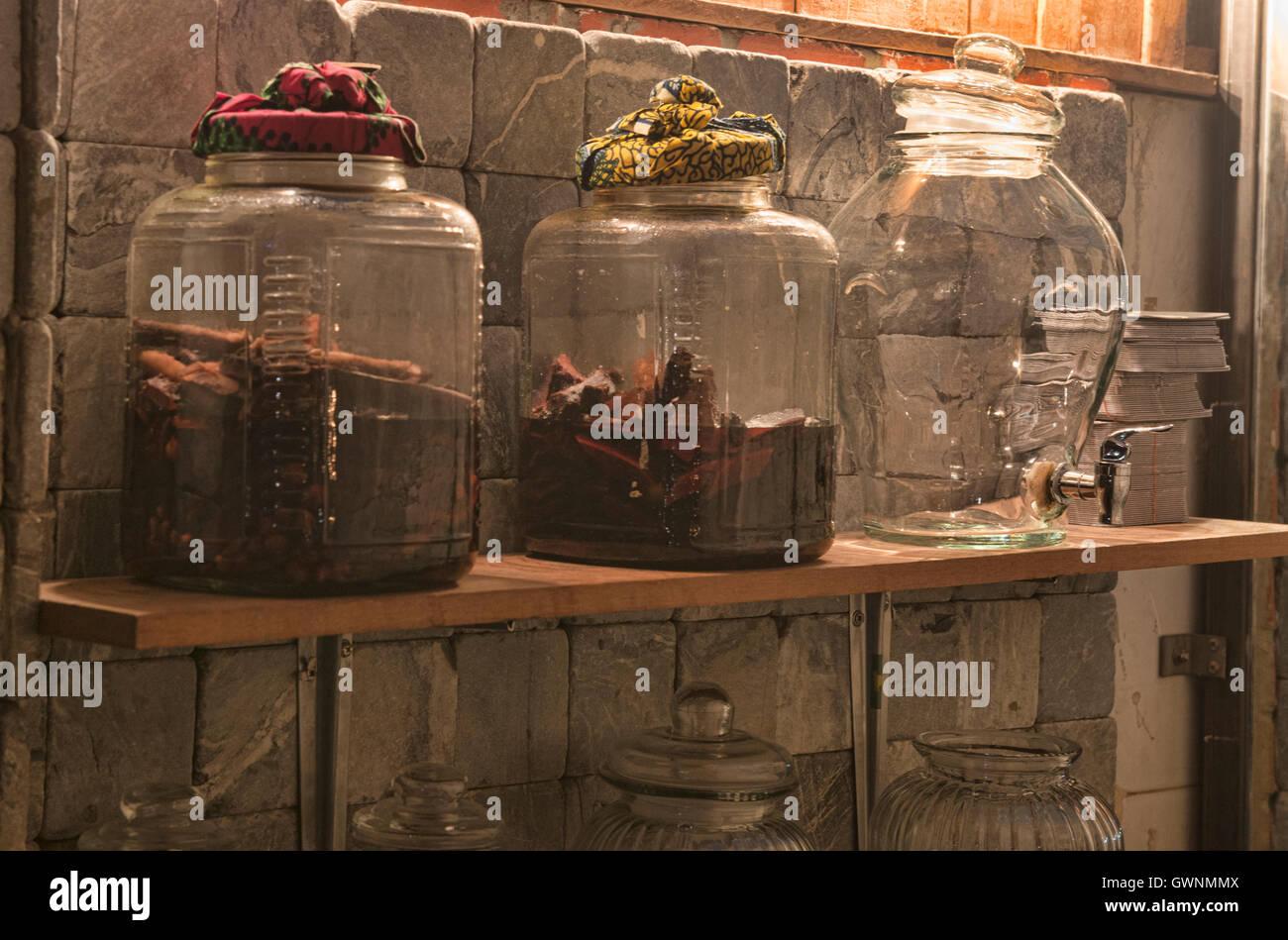 Jars of ya dong (Thai white spirits with medicinal herbs) at a bar in Bangkok, Thailand Stock Photo