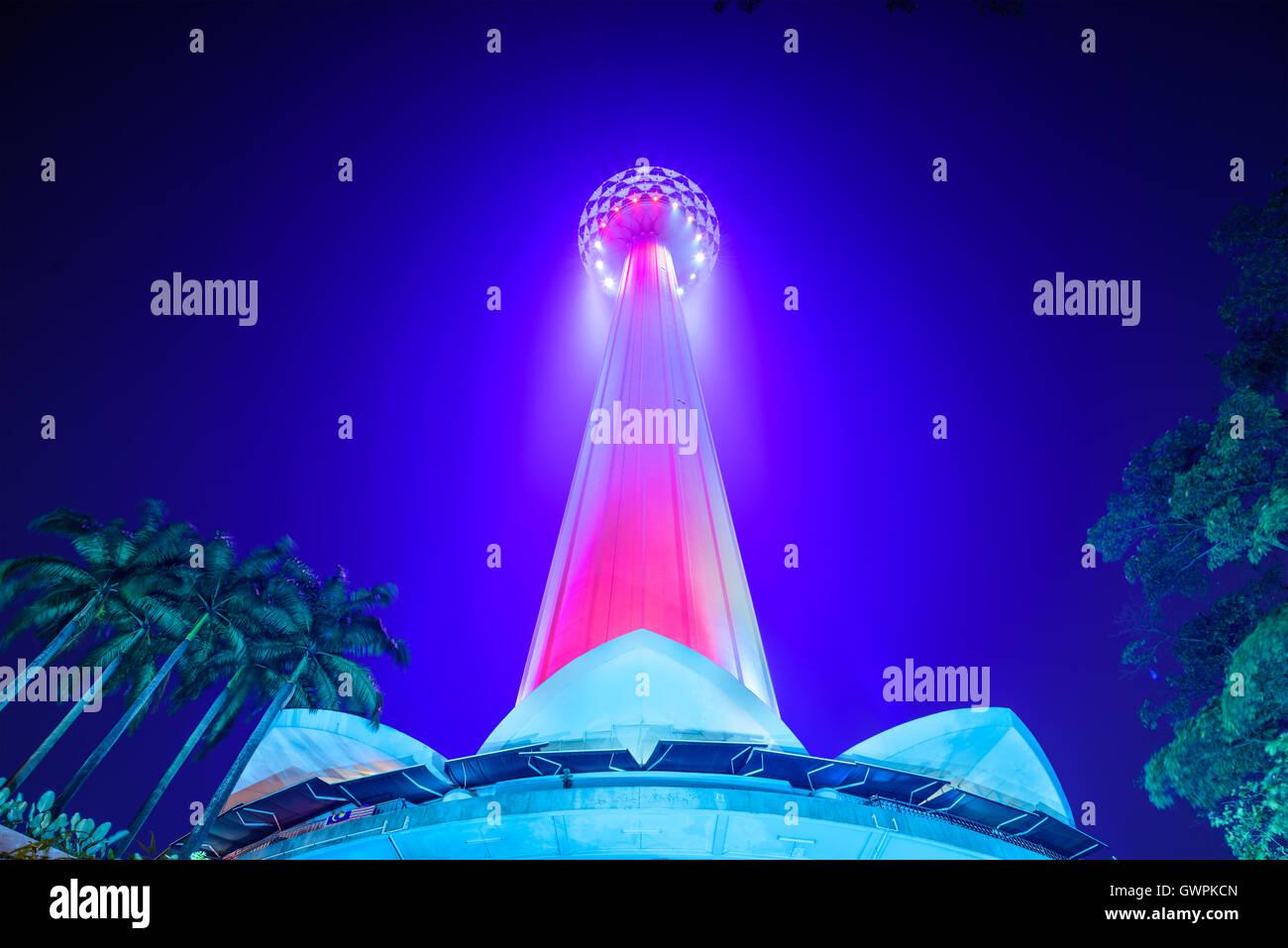 KL Menara Tower at night in Kuala Lumpur. - Stock Image