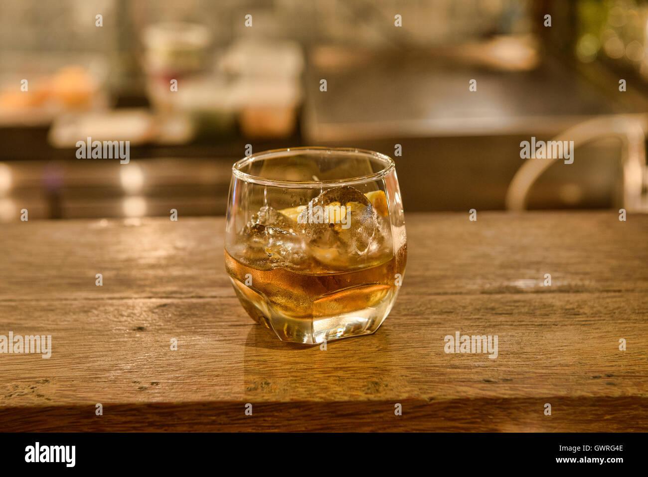 Shot of ya dong (Thai white spirits with medicinal herbs) at a bar in Bangkok, Thailand Stock Photo