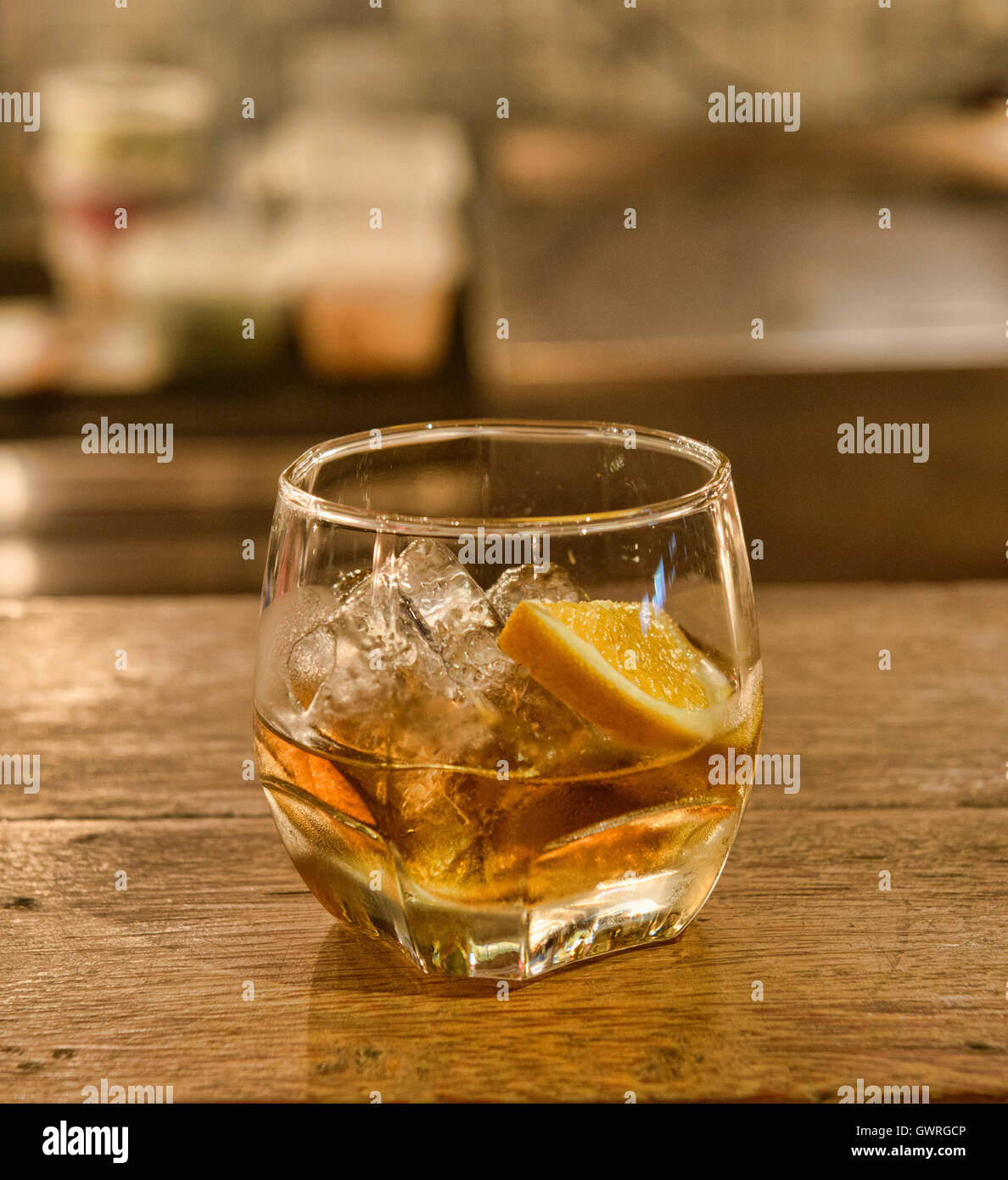 Shot of ya dong (Thai white spirits with medicinal herbs) at a bar in Bangkok, Thailand - Stock Image