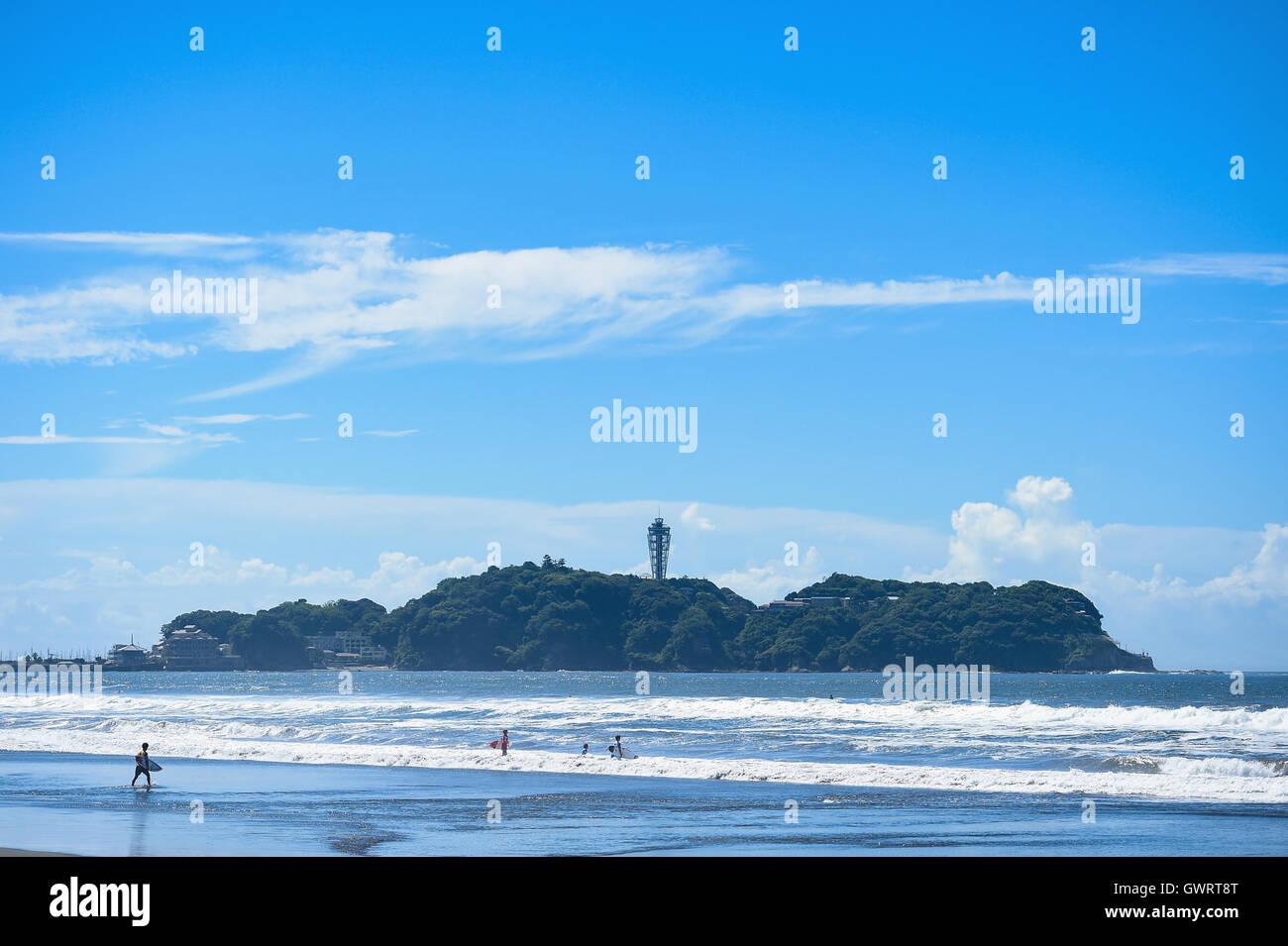 Surfers at the beach in Enoshima, Kanagawa Prefecture, Japan - Stock Image