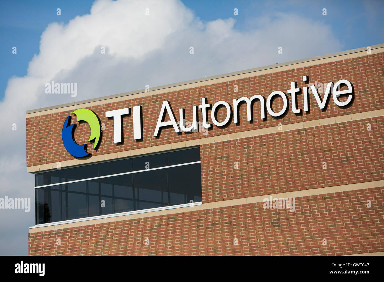 A logo sign outside of facility occupied by TI Automotive in Auburn Hills, Michigan on July 17, 2016. - Stock Image
