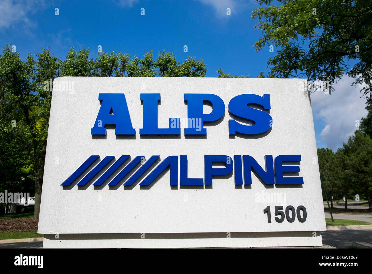 A logo sign outside of a facility occupied by Alps Electric Co., Ltd., and Alpine Electronics, Inc., in Auburn Hills, - Stock Image