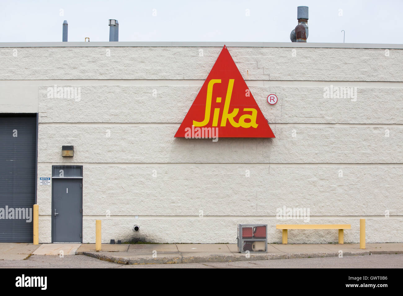 A logo sign outside of a facility occupied by the Sika