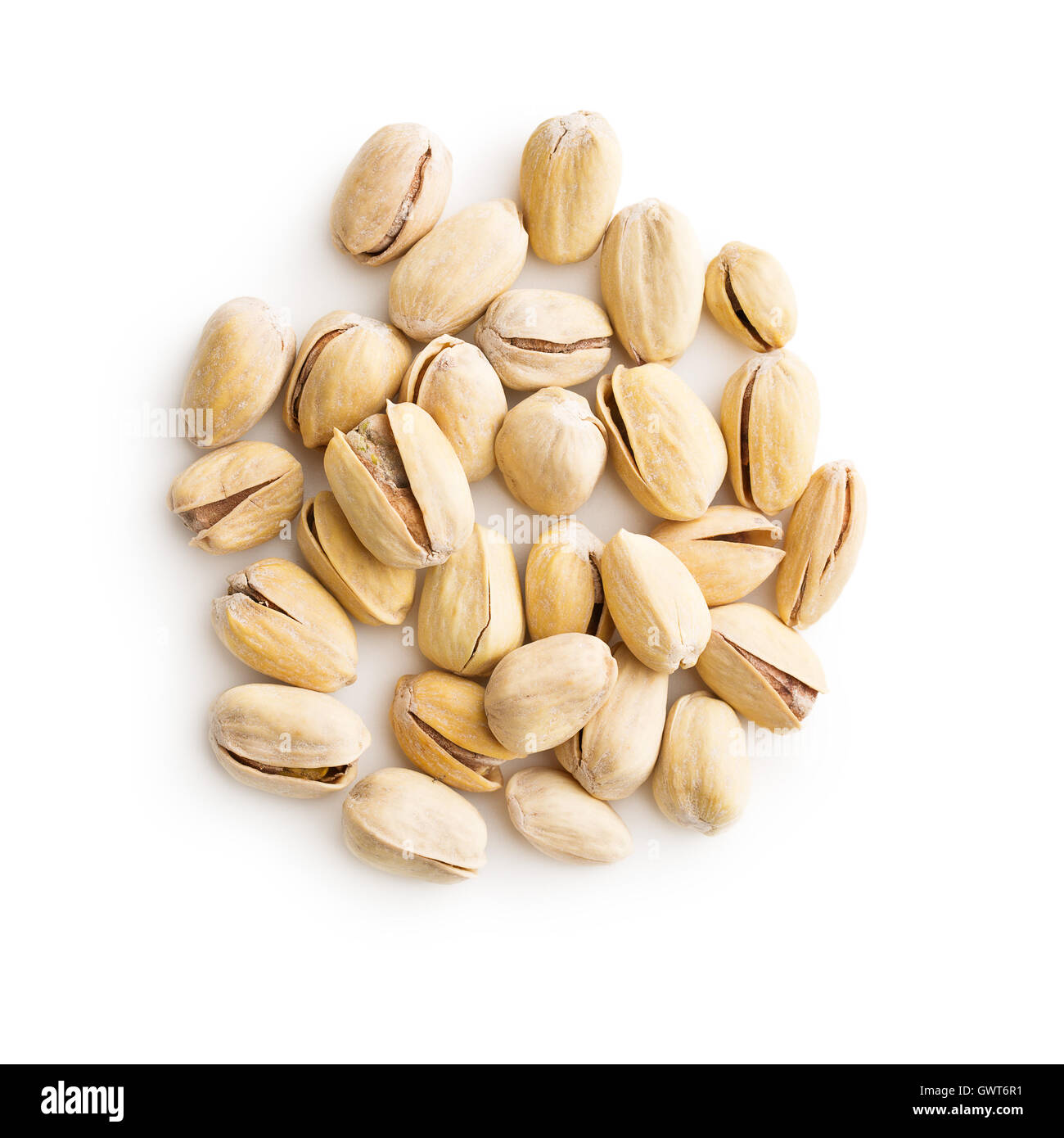 The pistachio nuts isolated on white background. Top view. - Stock Image