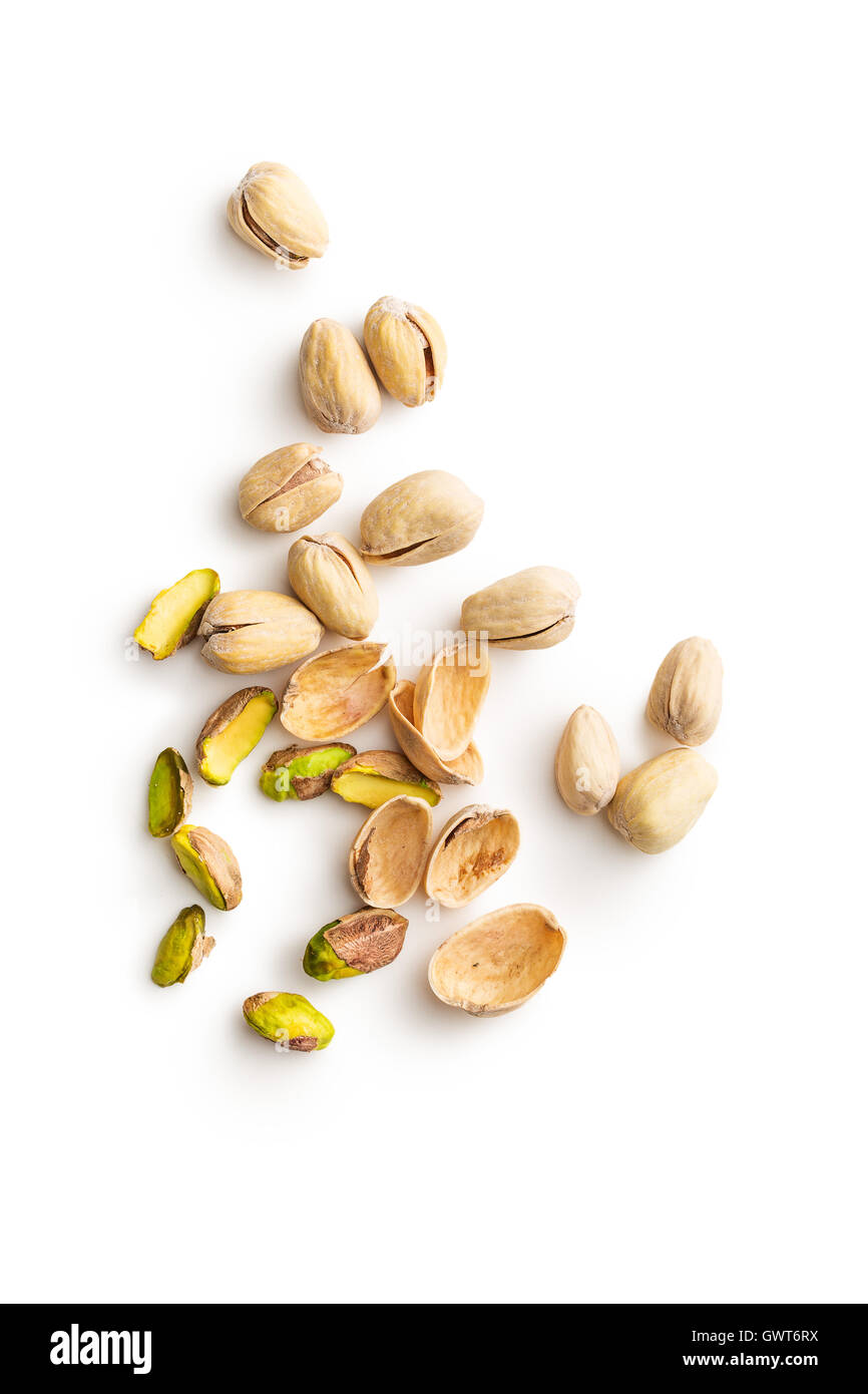 Peeled pistachio nuts isolated on white background. Top view. - Stock Image