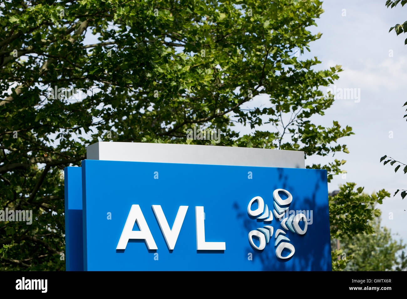 A logo sign outside of a facility occupied by Anstalt für Verbrennungskraftmaschinen List (AVL), in Plymouth, - Stock Image