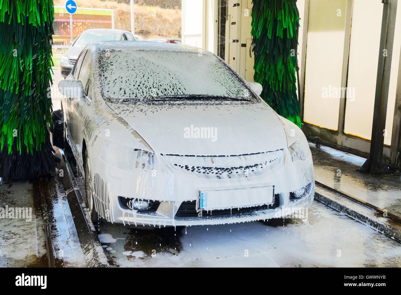 Washing gray car - Stock Image
