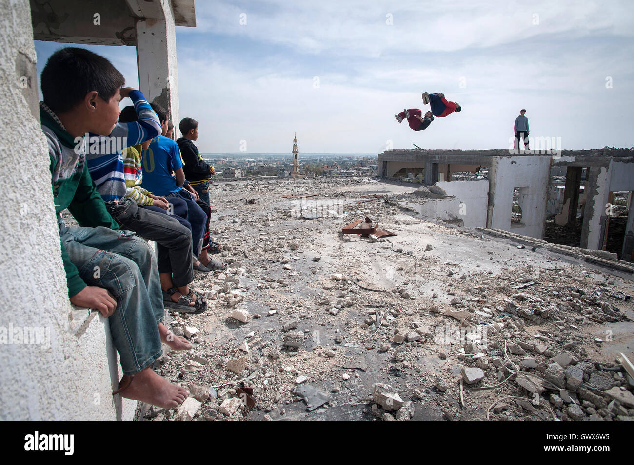 '3 Run Gaza' at the bombed out remains of a flat complex destroyed in 2014 during Israel's 'Operation - Stock Image