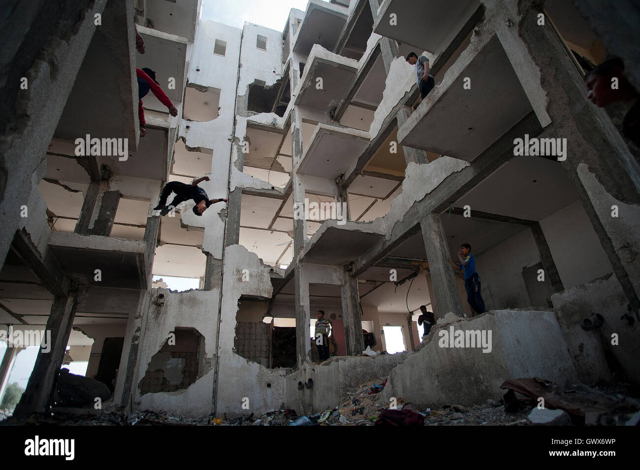 '3 Run Gaza' at the bombed out remains of a flat complex destroyed in 2014 during Israel's 'Operation Protective Stock Photo