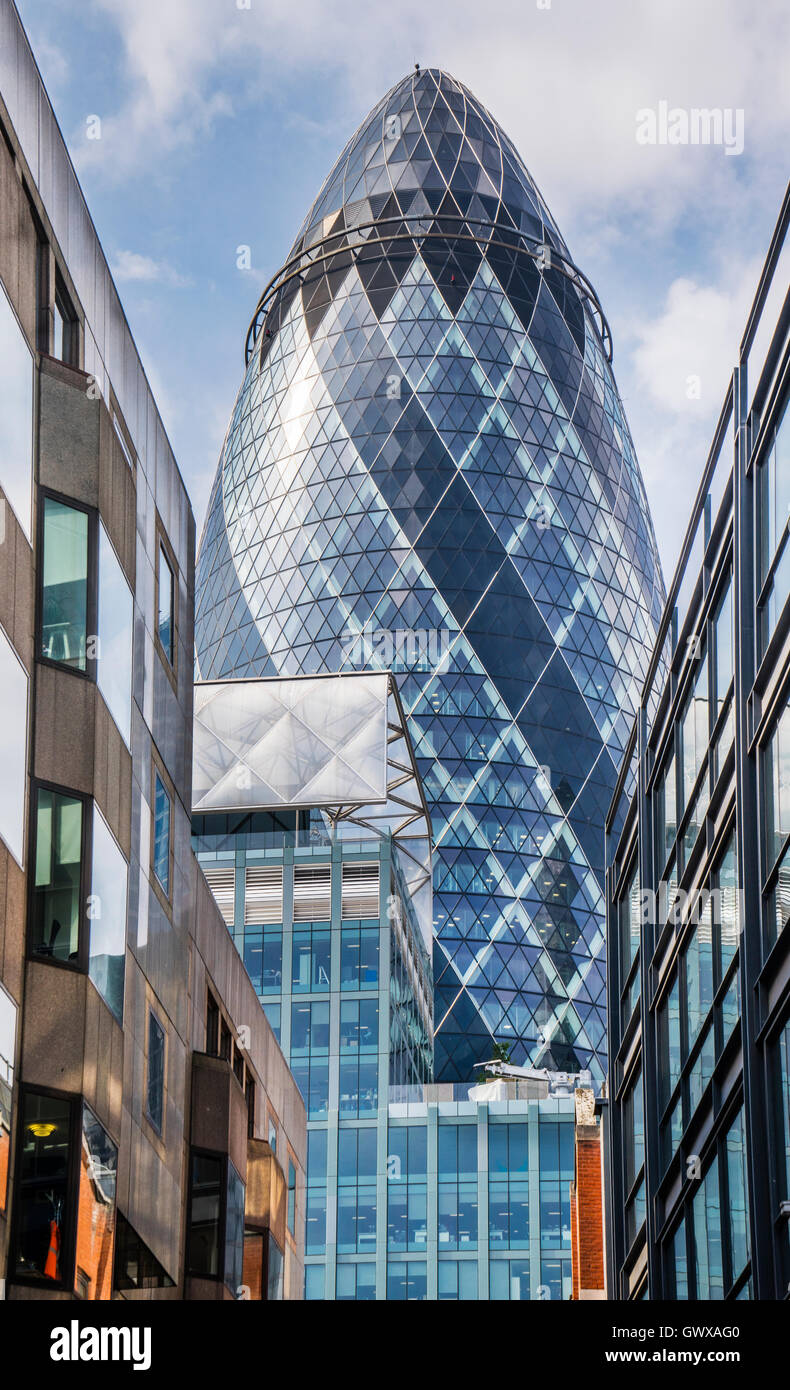 the neo-futuristic 30 St Mary Axe building, better known as The Gherkin, City of London, England, Great Britain - Stock Image