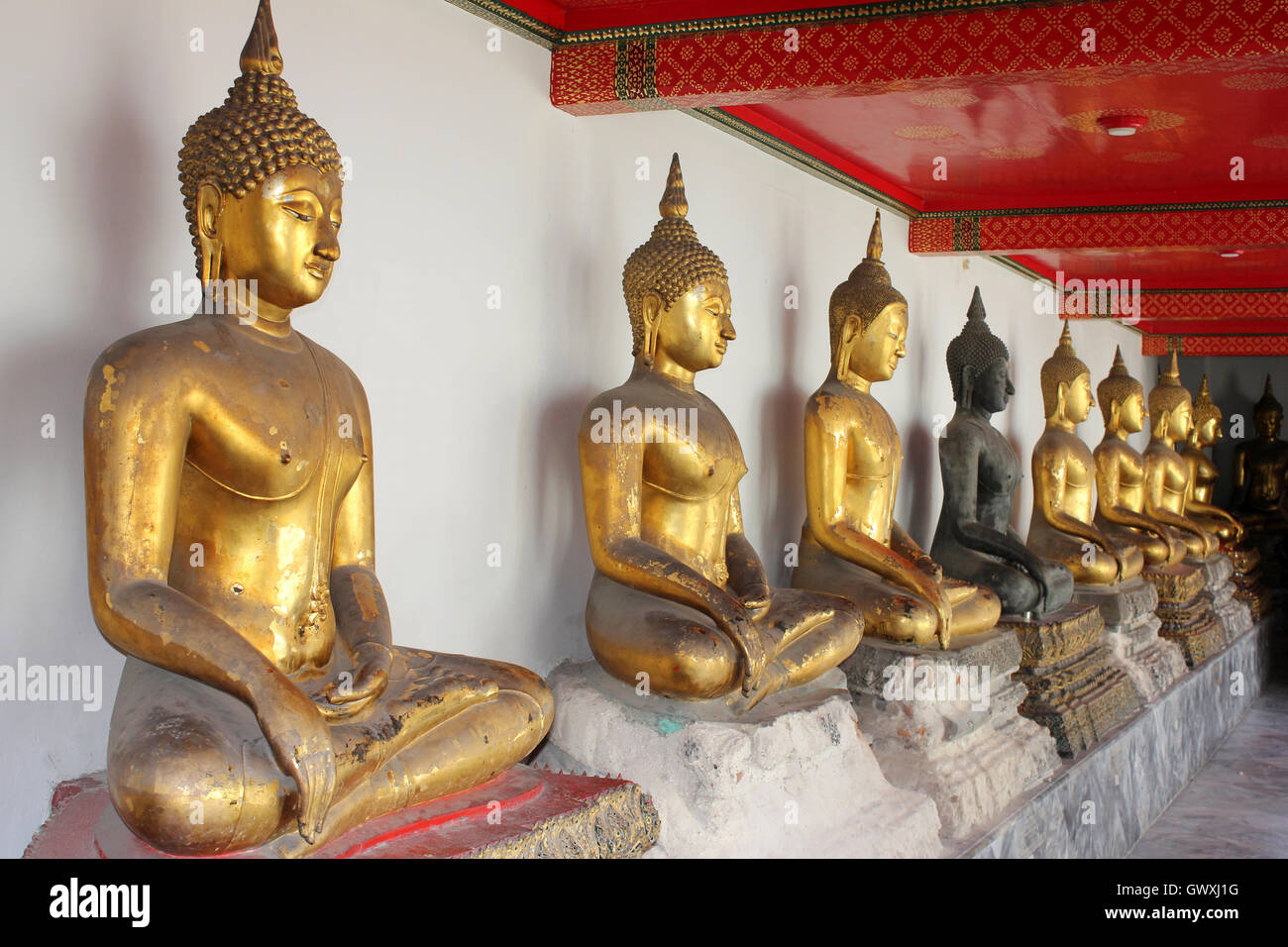 Line Of Sitting Buddhas At Wat Pho Temple, Bangkok, Thailand - Stock Image