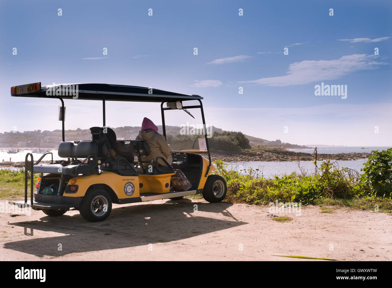 An electric buggy, on hire from The Scilly Cart Company, is the preferred choice to see the beautiful island of - Stock Image