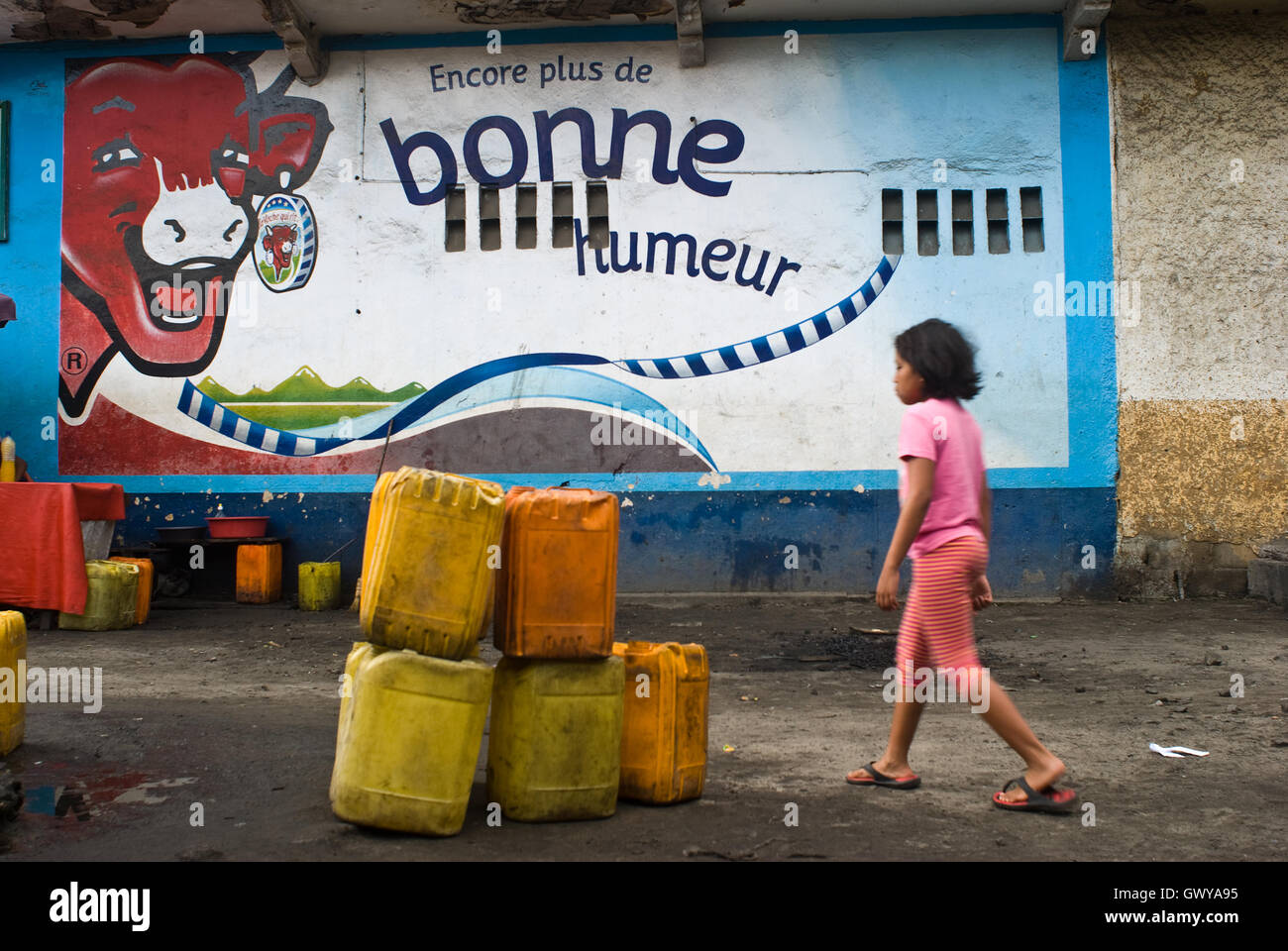 Mural ads for a famous French cheese ( 'La vache qui rit', 'The laughing cow') ( Madagascar) - Stock Image