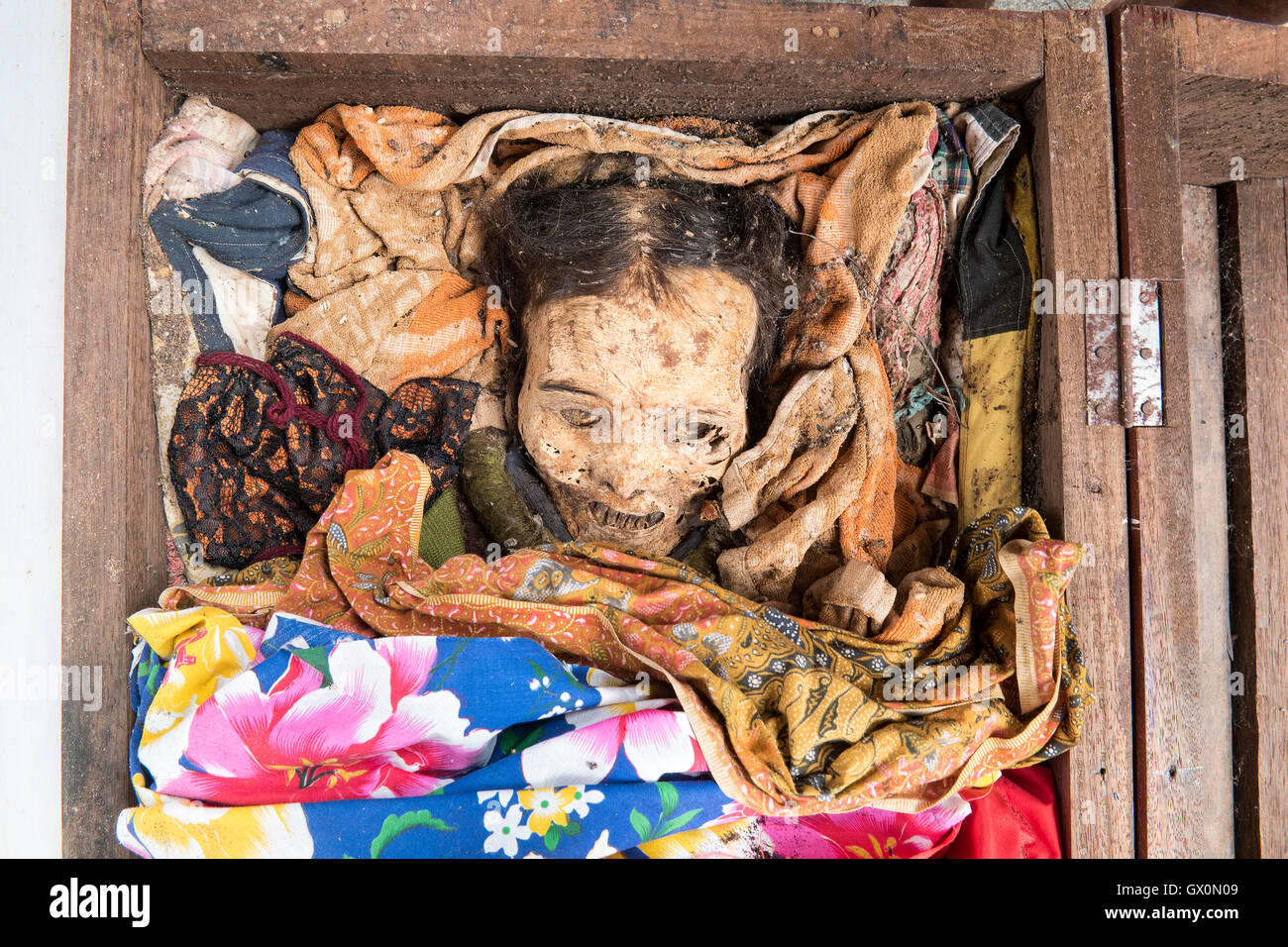 The dead body to bring up by the relatives to clean off their corpses, and dress them - Stock Image