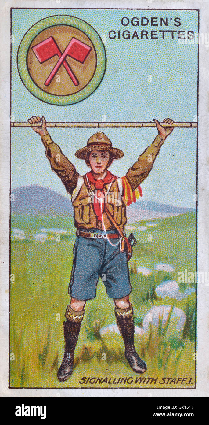 Ogden's cigarette card of a boy scout signalling with a staff - Stock Image