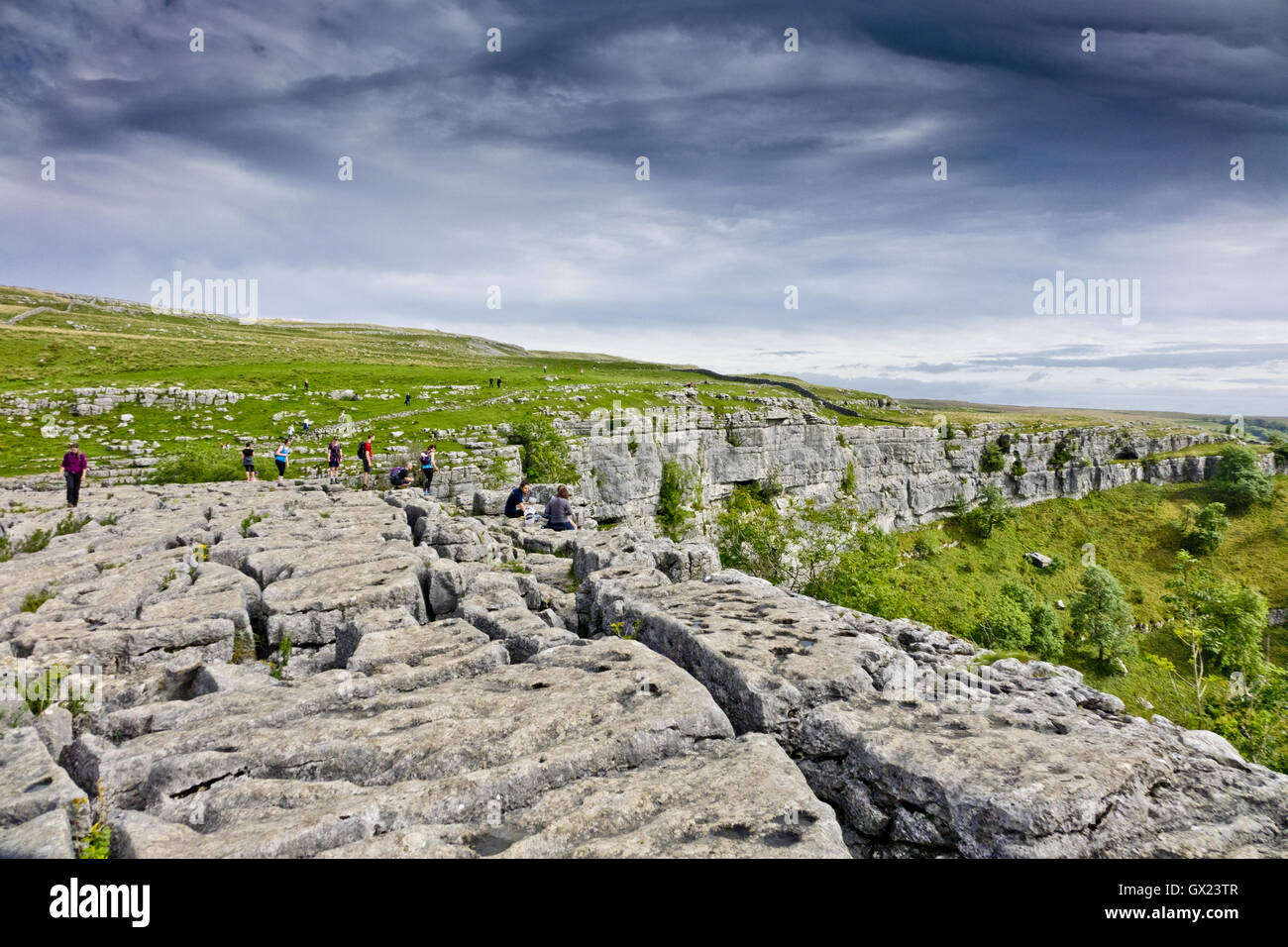 limestone pavement is above the cove Malham Cove - Stock Image