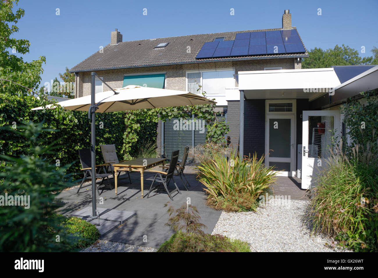 House with PV solar panels on a sunny profitable day in the Netherlands, Europe - Stock Image