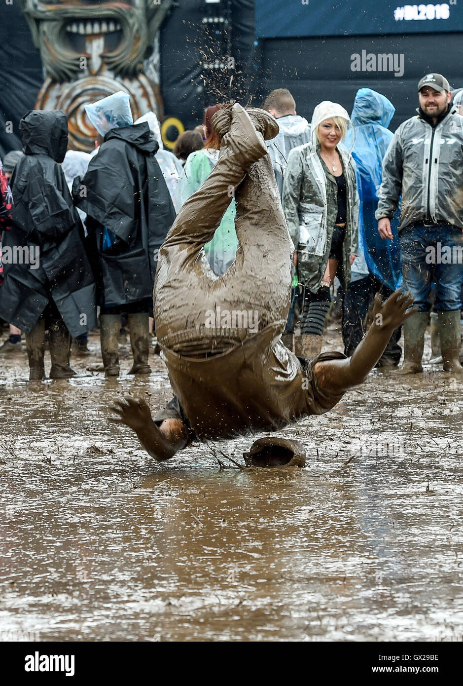 Download Festival revellers in the mud Featuring: Atmosphere