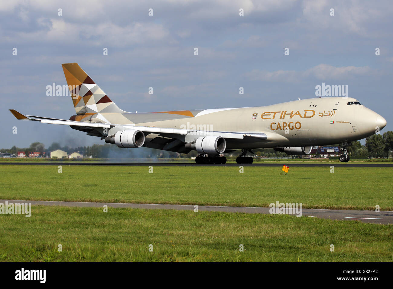 Etihad Airways (Atlas Air) Boeing 747-400 approaches  runway 18R at Amsterdam Schipol airport. - Stock Image