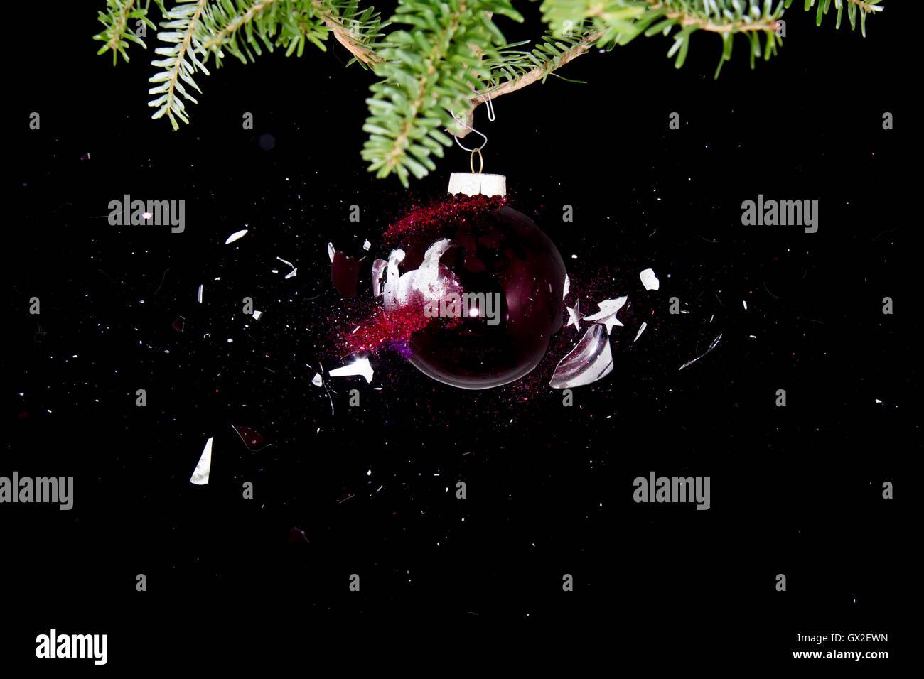 Christmas ball exploding. - Stock Image