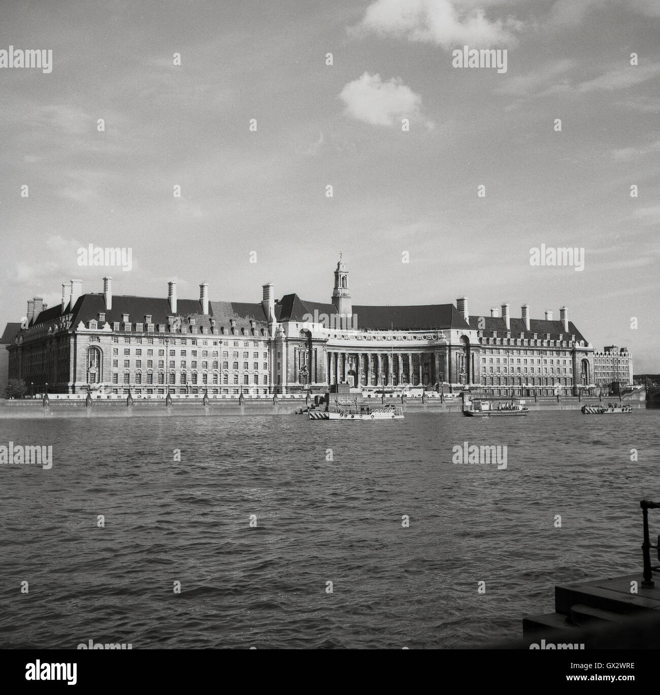 1950s, historical, view across river Thames of County Hall, South bank, London, the former home of the Greater London - Stock Image