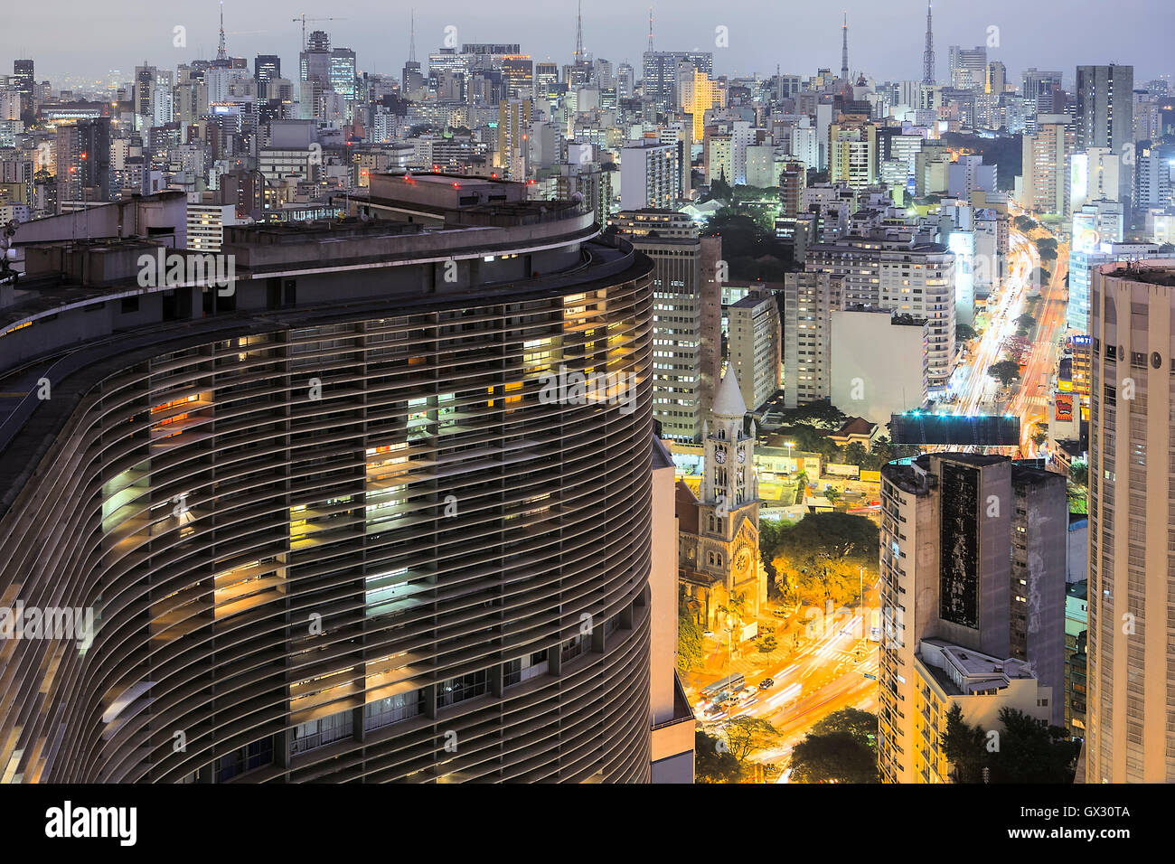 View of Sao Paulo city center with Niemeyer's Copan Buliding in the foreground - Stock Image