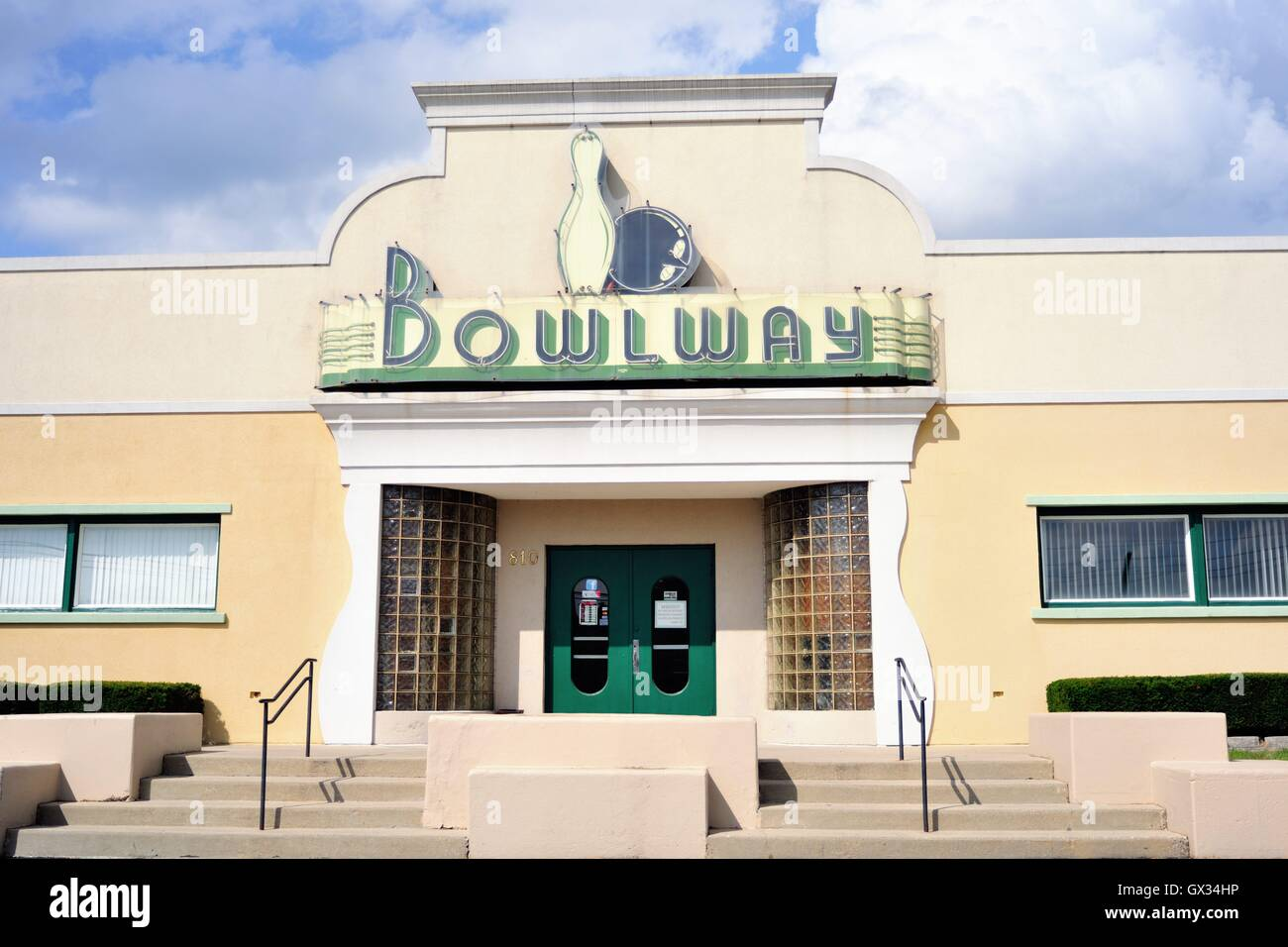 An art deco-styled bowling alley in Elgin, Illinois. The old fashioned building represents a throwback link to another - Stock Image