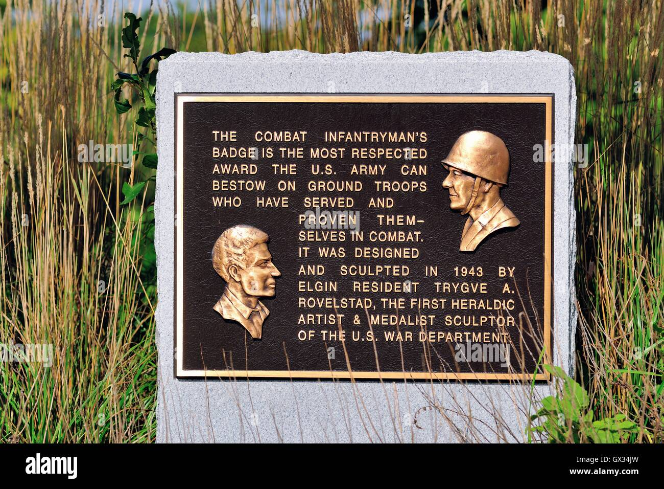 A plaque commemorating the combat infantryman's badge and its design at a veterans memorial in Elgin, Illinois, - Stock Image