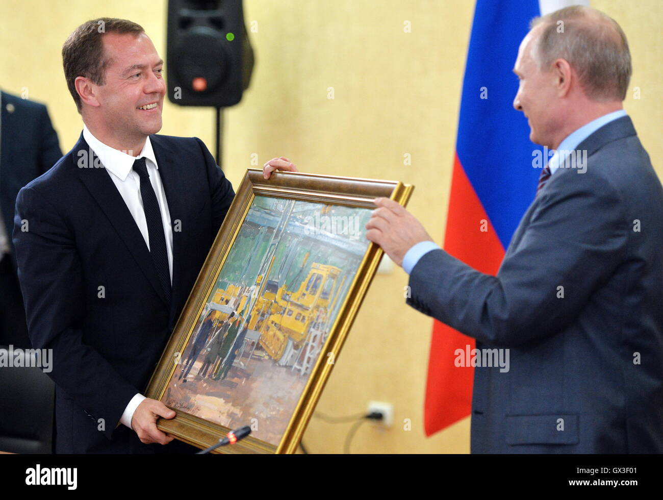 Crimea, Russia. 15th Sep, 2016. Russia's President Vladimir Putin (R) presents In the Workshop painting to Russia's - Stock Image