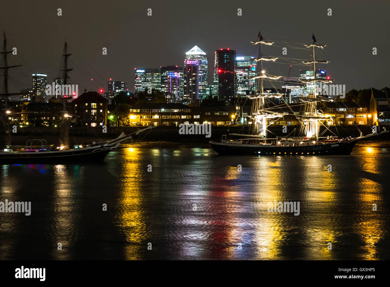London, UK. 15th September, 2016. Royal Greenwich Tall Ships Festival with Canary Wharf buildings seen in the background - Stock Image