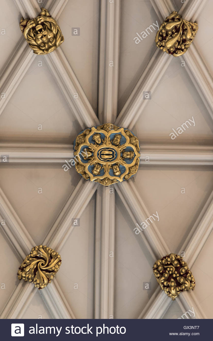 An unusual ceiling boss in York Minster showing the soles of a pair of feet as if one were looking up at Christ's - Stock Image